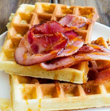 Maple Syrup waffles!!!! The sweet, buttery, smokey maple syrup is infused into these waffles; they are sweet and totally delicious but to make things even better then there is bacon. Crispy wonderful bacon that is glazed with maple syrup. This is a salty sweet perfection of a breakfast!