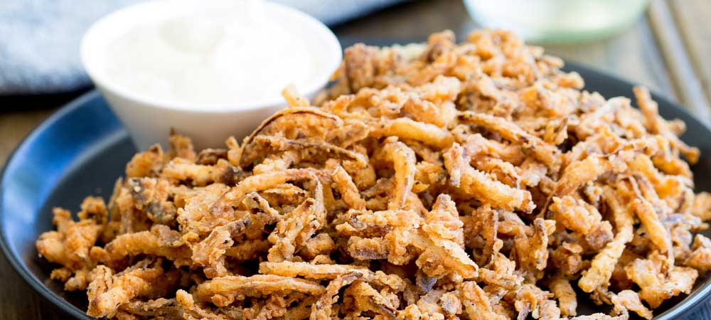 These crispy crunchy shoe string onions are so good! They taste sweet and crunchy with a background hint of salt and spice. I think I could eat a whole plateful myself! They are delicious as a snack or if you can resits eating them you could add them to a steak sandwich. Oh yes that is pure heaven!!!!!