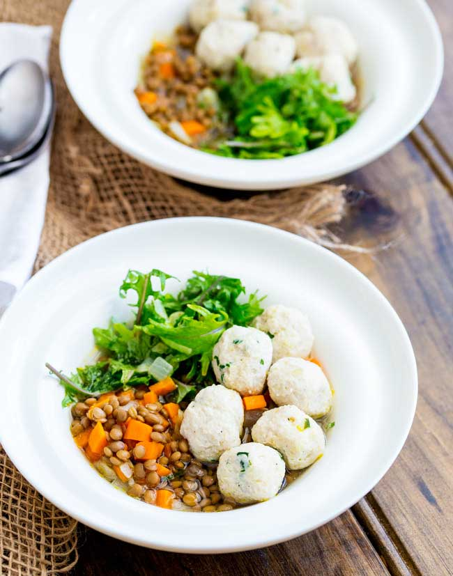 This Lentil Bowl with kale and chicken meatballs is the perfect mix of comfort food and healthy lunch. Hearty and warming without being heavy or stodgy but light enough for a warm day. It really is the dish for all seasons!
