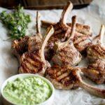 These Grilled Lamb Lollipops makes a great dish to feed the whole family. Deliciously juicy lamb chops, seared to perfection served with a sweet spring pea and lemon dip.