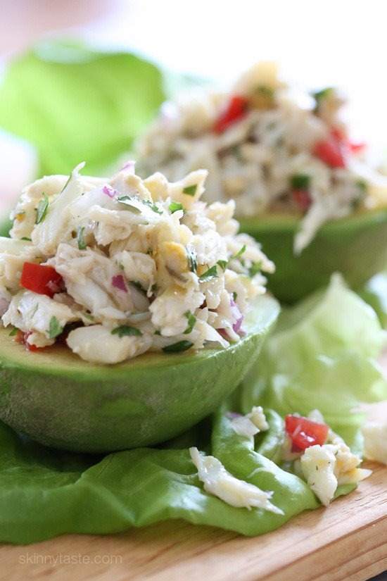 peeled avocado piled high with lump crab salad