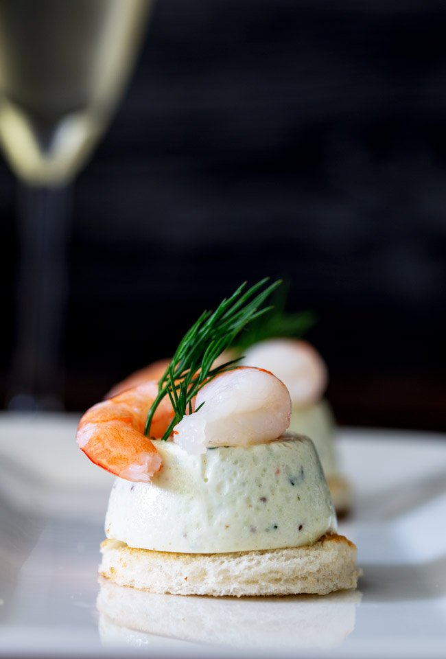 These Cucumber Mousse And Dill Shrimp Bites are sublime. The subtle and refreshing taste of cucumber combined in a soft heavenly mousse, sat on top of a crispy toast circle and topped with a succulent shrimp and the freshness of dill.
