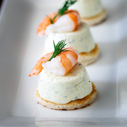 These Cucumber Mousse And Dill Prawn Bites are sublime. The subtle and refreshing taste of cucumber combined in a soft heavenly mousse, sat on top of a crispy toast circle and topped with a succulent prawn and the freshness of dill.