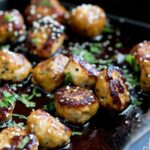 Sweet, sticky and delicious. These tray baked sticky sesame chicken meatballs are packed with flavour and bake easily in the oven for a perfect week night meal.