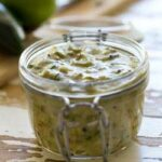 This mild Green Enchilada Sauce is made with roasted green chiles and a few easy to find herbs and spices. It is delicious, fresh and so simple to make that once you have tried it you will never reach for a can of sauce again. Get a batch made and enjoy the best green enchiladas this Cinco De Mayo.
