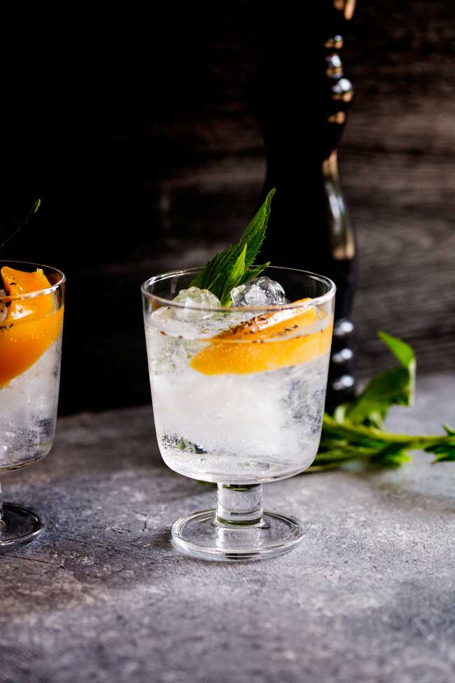 This Mango and Black Pepper Gin and Tonic is a deliciously different way to enjoy the classic G&T. The sweet mango and fiery black pepper sing together and make this a drink to remember.