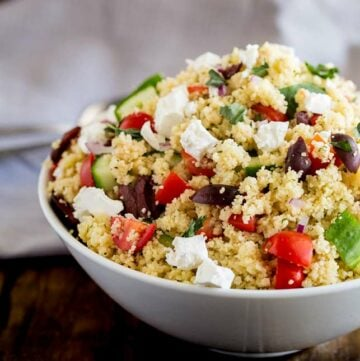white bowl with couscous and greek veg