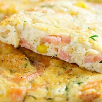 This Smoked Salmon Frittata is baked in a sheet pan, making it perfect for feeding a group. Enjoy it at any time of day. Personally I like it for brunch with a glass of bucks fizz.