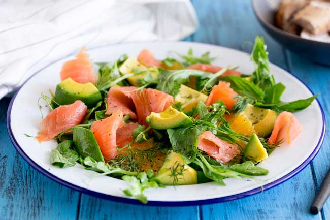 Smoked Salmon, Sweet orange, peppery leaves, fresh herbs and creamy avocado. This smoked salmon, orange and avocado salad is packed with flavours and textures. So delicious and so beautiful it is sure to become a firm favourite.