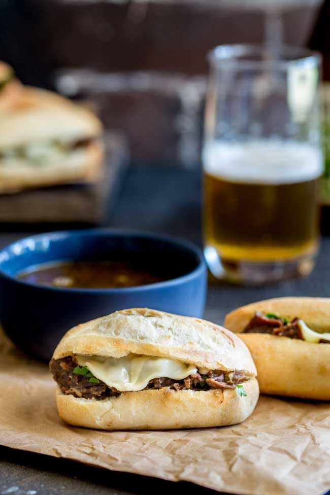 These Pressure Cooker Italian Beef Subs are the perfect midweek meal for the whole family. Juicy succulent shredded beef, stuffed inside soft rolls topped with provolone and dunked into a flavour packed gravy/sauce. Everyone who tries these loves these and they are so simple to make. Recipe includes instructions for Instant Pot and Stove top pressure cookers.