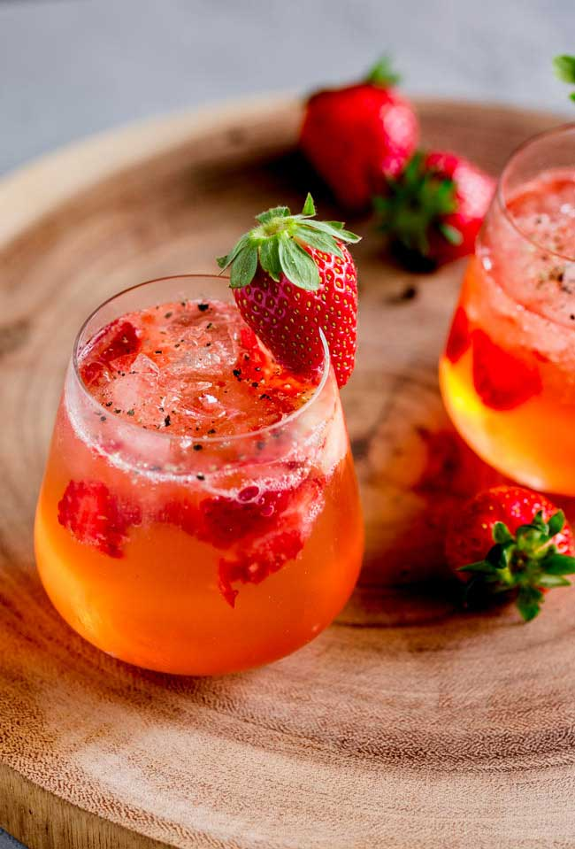 Sweet strawberries, fragrant gin and fiery pepper. This Strawberry and Black Pepper Gin and Tonic is a different and delicious way to enjoy your Gin and Tonic. From Sprinkles and Sprouts.