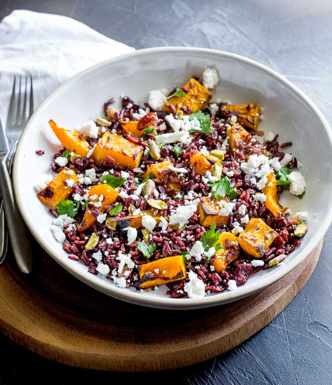 This Black Rice, Goats Cheese and Maple Roasted Pumpkin Fall Salad has it all!!! Nutty sweet black rice, sweet smoky pumpkin, fresh tangy goats cheese, sweet cranberries and crunchy pistachios. Delicious as a main or a side, this is the perfect dish for fall. From Sprinkles and Sprouts.