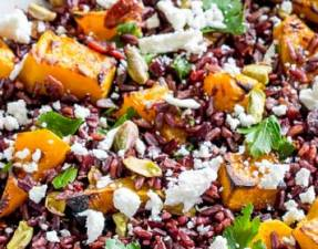This Black Rice, Goats Cheese and Maple Roasted Pumpkin Fall Salad has it all!!! Nutty sweet black rice, sweet smoky pumpkin, fresh tangy goats cheese, sweet cranberries and crunchy pistachios. Delicious as a main or a side, this is the perfect dish for fall. From Sprinkles and Sprouts