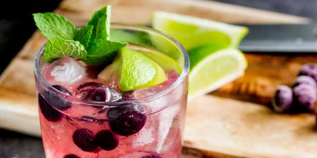 Slight sweet blueberries with tart lime and the zing of mint. This Blueberry, Lime and Mint muddled gin and tonic is the perfect balance of flavours. From Sprinkles and Sprouts