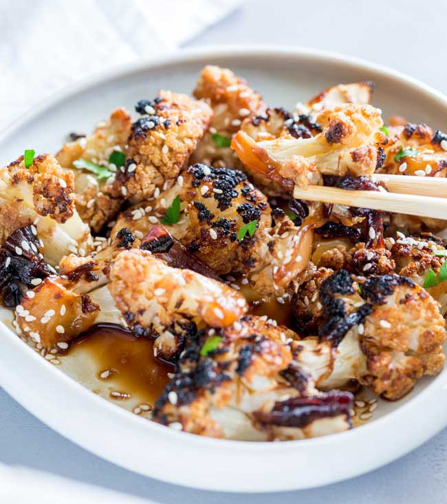 This Oven Baked Honey Soy Sesame Cauliflower is an umami rich dish, full ofsticky, sweet flavours that will delightvegetarians andmeat eaters alike. It is quick to prepare and thenhappily bakes in the oven. From Sprinkles and Sprouts
