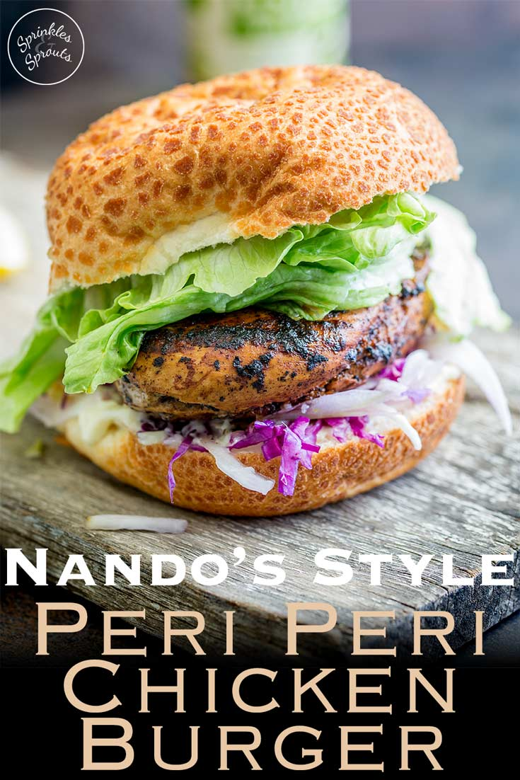 This juicy Peri Peri chicken burger is perfect for Nando lovers. The homemade marinade takes the humble chicken breast and turns it into a juicy and delicious dinner. Plus the fennel slaw!!! Oh so refreshing and perfect against the slight spicy of the burger. Recipe from Sprinkles and Sprouts | Delicious food for easy entertaining. #burger #periperi #piripiri #nandos #grilling #chickenburger