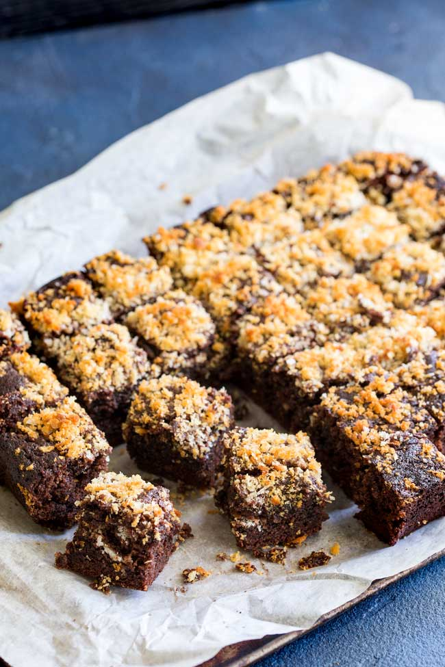 Tray of chocolate brownies with a salted panko topping.
