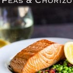 Pin. Zoomed in shot of the crispy salmon on the green peas in a white bowl with a yellow napkin and wine glass.