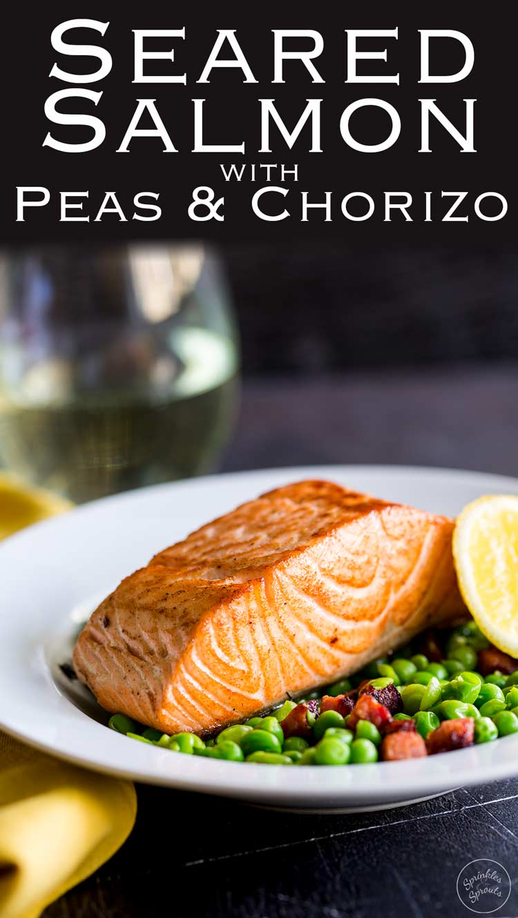 Succulent salmon with a crispy skin, sat on a bed of crushed sweet peas and spicy chorizo. This Seared Salmon with Peas and Chorizo is elegant yet simple. A perfect entree for entertaining. Recipe from Sprinkles and Sprouts | Delicious food for easy entertaining.