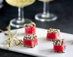 Feature Picture. Seared Sesame Tuna Bites on a white platter.