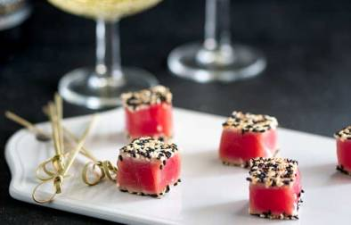 Feature Picture. Seared Sesame Tuna Bites on a white platter.