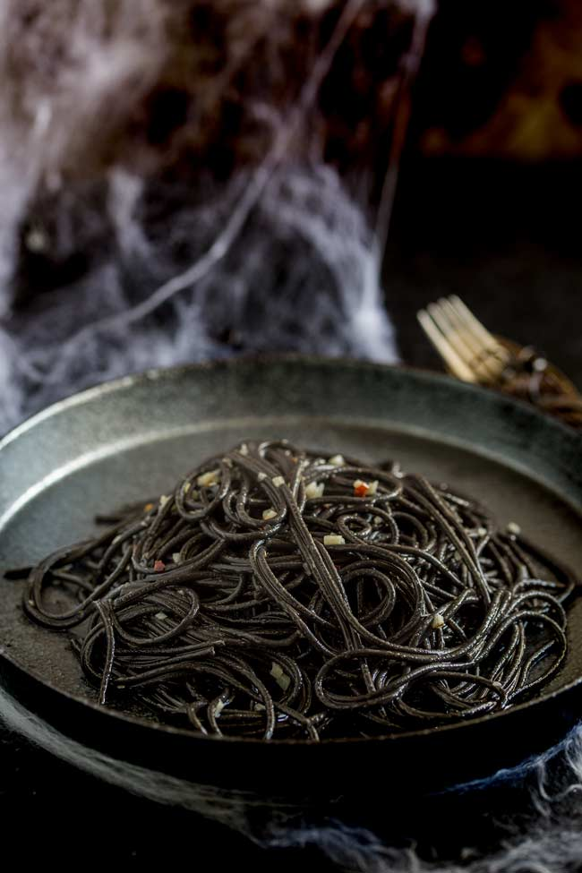 This Witches hair pasta is the perfect dinner for Halloween night. Jet black strands of squid ink pasta dressed with a garlic and chilli oil. Delicious, simple and dramatic. And there is plenty of garlic in there to keep the vampires at bay....well it is Halloween!Recipe from Sprinkles and Sprouts   Delicious food for easy entertaining.