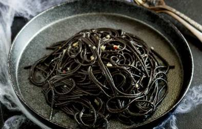 This Witches hair pasta is the perfect dinner for Halloween night. Jet black strands of squid ink pasta dressed with a garlic and chilli oil. Delicious, simple and dramatic. And there is plenty of garlic in there to keep the vampires at bay....well it is Halloween! Recipe from Sprinkles and Sprouts | Delicious food for easy entertaining.
