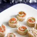 Smoked Salmon and Dill Pinwheels on a white platter.