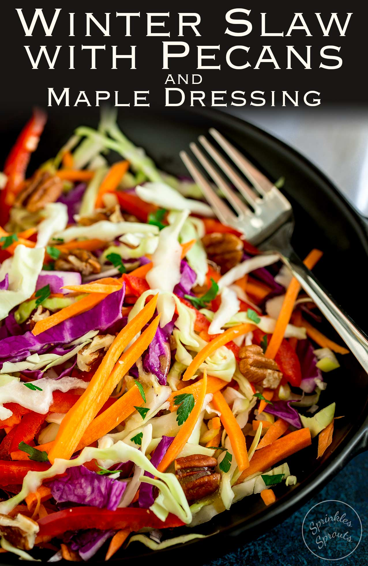 This winter slaw, is packed with crisp crunchy veg. The sweet maple dressing and creamy pecans make it extra special and a delicious and fresh side for the festive season. Recipe by Sprinkles and Sprouts   Delicious Food for Easy Entertaining