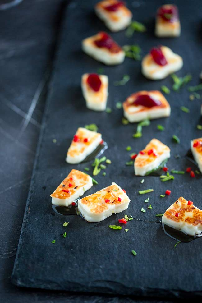 Platter showing both the grilled halloumi topped with red chilli and topped with red cranberry