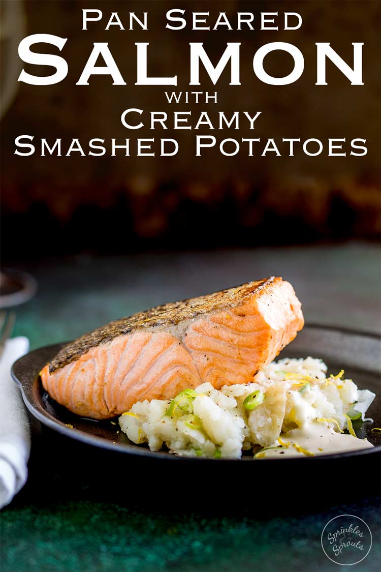 A juicy seared salmon fillet, sat on top of soft fluffy smashed potatoes, spiked with scallions and drizzled with horseradish cream. ThisPan Seared Salmon with Creamy Smashed Potatoes is an elegant yet simple dinner party main course. Recipe by Sprinkles and Sprouts   Delicious food for easy entertaining.
