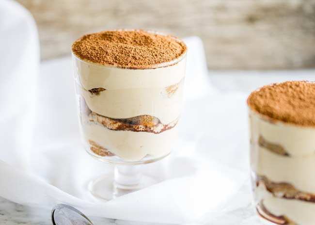 Close up showing the pillowy cream on the individual tiramisu