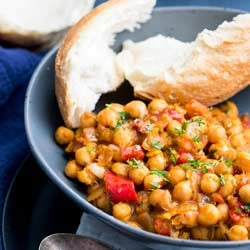 This Tomato and Chickpea Stew is low fat, gluten free and vegan. It is also packed full of fresh Italian flavors. The rich tomato, sweet onions and plenty of Italian herbs, make this stew a delicious yet simple dinner idea. Recipe by Sprinkles and Sprouts   Delicious food for easy entertaining