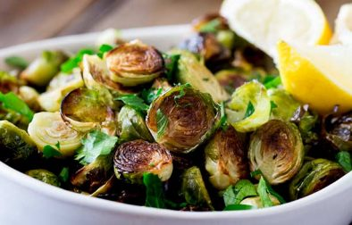 These Roast Brussel Sprouts are an amazing and delicious side dish that are the perfect side for so many different dishes. The brussel sprouts are simply dressed in olive oil with plenty of salt and pepper, before being roasted to a crisp perfection, then finished with lemon zest and fresh parsley. Recipe by Sprinkles and Sprouts | Delicious Food for Easy Entertaining #sidedish #brusselsprouts #dinner #recipe #roastdinner
