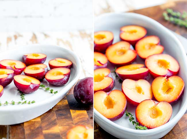 Split picture, showing two picture of the uncooked plums halves sat on thyme sprigs in a irregular white roasting dish.