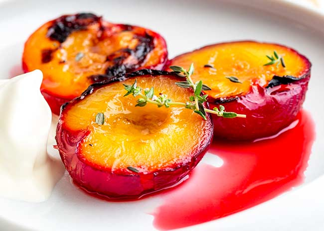 Real close up showing the tender roasted plums and the caramelized brown sugar