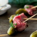 Strips of tender, sweet pickle marinated beef paired with the crunchy of a dill pickle. These Dill Pickle Beef Skewers are a delicious and easy party appetizer. Or serve them on game night as a easy to eat snack.