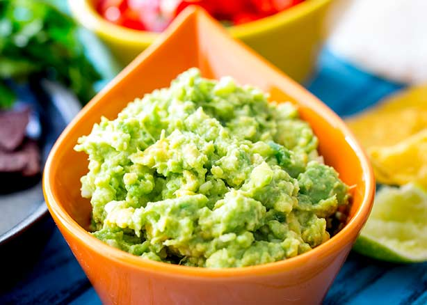 Close up on the nubbly texture of this gorgeous prepare ahead guacamole.
