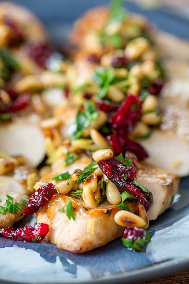 Close up on the gremolata, showing the toasted pine nuts and cranberries.