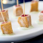 Pin image, showing seared tuna skewers on a white platter with text at the bottom of the picture
