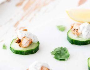 3 tandoori chicken bites on a marple platter garnished with cilantro