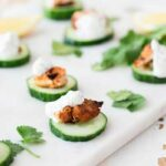 Small sq image showing the chicken bites and their coriander garnish