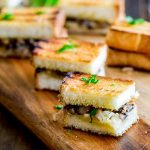pin image with a close up on the mushroom and gruyere sandwich with text at the bottom