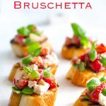 Pin image, text at the top and then a close up on the bruschetta, showing the bright colours of the topping.