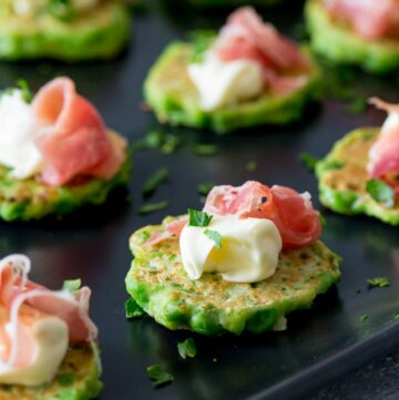 an overhead SQ picture showing the smooth mascarpone and curl of prosciutto on the pea fritter