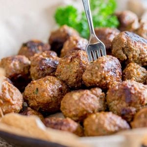 sq image showing a close up of a fork spearing a paprika beef meatball
