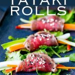 for pinterest showing a close up on 3 beef tataki rolls on a blue plate with text at the top
