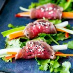 of a close up on the beef tataki rolls, showing how they are rolled