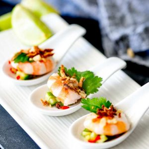 showing the finely diced salad under the shrimp on the spoon canapé spoons