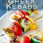 pinterest image showing a close up on a halloumi and vegetable kebab with text at the top